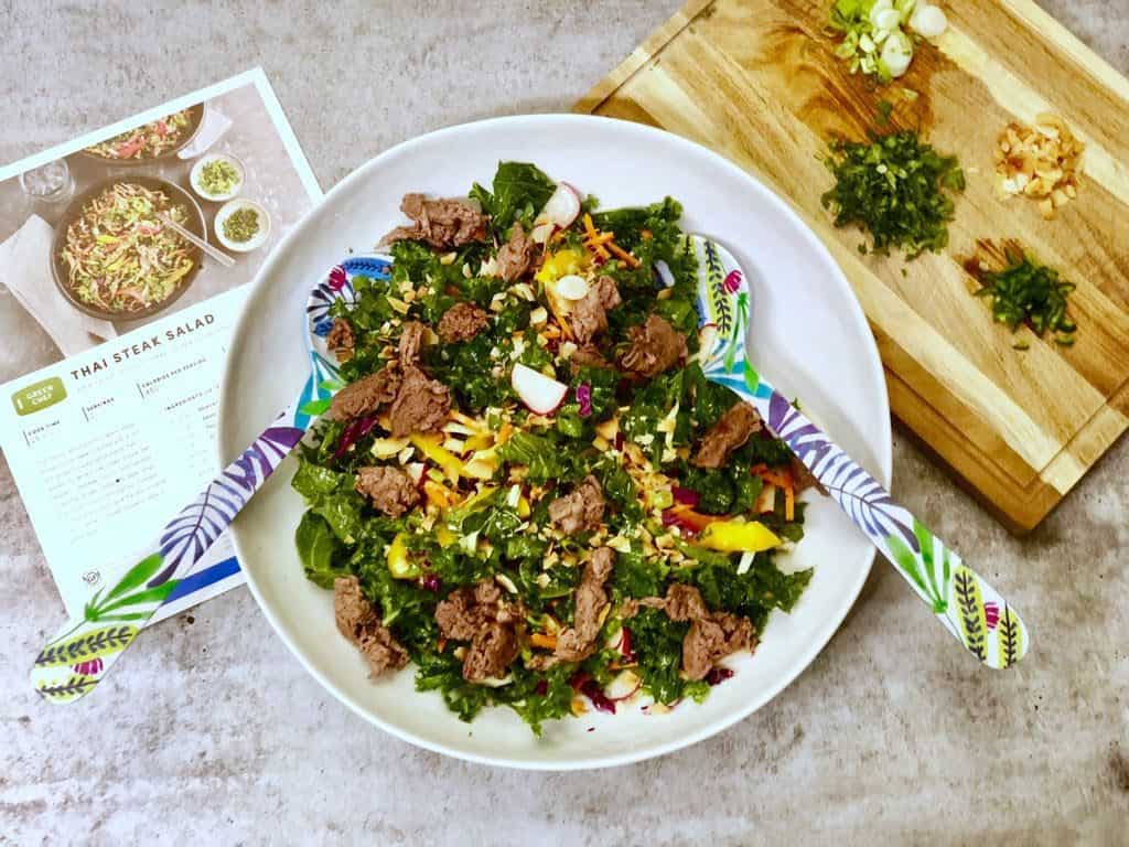 Thai steak salad with kale, coconut flakes and sesame seeds
